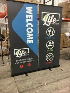 Life Sanctuary in Weatherford Tx uses black hardware and black vinyl on their stand-up banners to create sleek, classy hospitality signs. Church Lobby, Church Foyer, Kids Church Rooms, Church Nursery, Church Interior Design, Church Stage Design, Church Ministry, Ministry Ideas, Youth Ministry