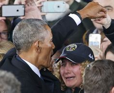 Obama shakes the hand of a supporter while another cries moments before the former preside...