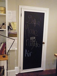 flat door, framed out with molding and painted with chalkboard paint.
