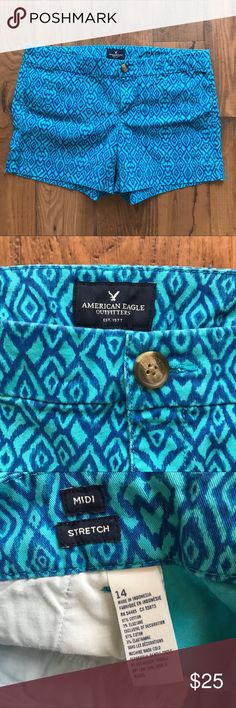 """American Eagle Blue Printed Midi Stretch Shorts American Eagle Blue Printed Midi Stretch Shorts. Size 14. Laying the shorts flat the waists measures 18"""" across. The rise is about 8.5"""". The inseam is about 5"""". American Eagle Outfitters Shorts"""