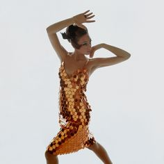 """Marisa Berenson in a dress by Gayle Kirkpatrick for Atelier of """"copper sequins, full-moon size."""""""