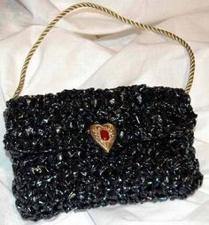 Recycled VHS tape clutch--sweet idea for what to do with old tapes