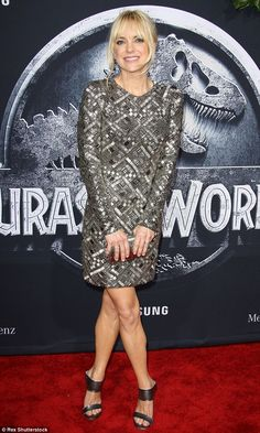 Shimmering: Faris, 38, looked gorgeous in a metallic mini dress which she teamed with gunm...