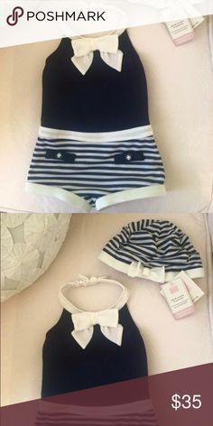 Janie & Jack swimsuit & swim cap The most adorable little swimsuit ever! Pinup style with navy and white stripes. Swimsuit is NWOT and cap is NWT. The swimsuit is 12-18 months but runs small and the cap is 12-24 mo. Janie and Jack Swim One Piece