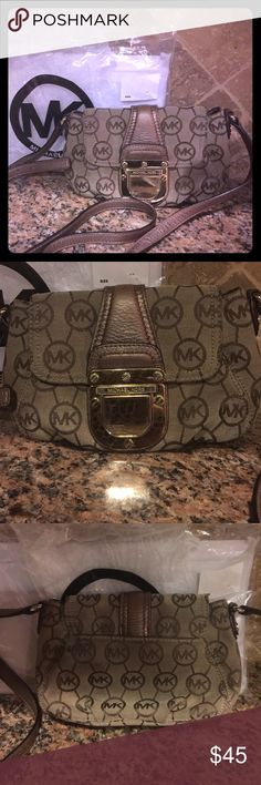 Michael Kors Crossbody Michael Kors Metallic/gold signature Crossbody. This is preloaded with a few flaws (metal has some scratches and a dark spot on the back) but there is still a lot of life left in this bag. Priced to sell! Michael Kors Bags Crossbody Bags