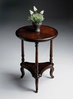 "Butler Specialty 1590024 Accent End Table, Plantation Cherry by Butler Specialty Company. $239.00. Cherry veneers. Lower shelf. Size: 26""H x 19""W x 19""D. Round shape. Color: Plantation Cherry. Finish:Plantation Cherry  Accent Table  Selected solid woods and choice cherry veneers.  Six- way matched cherry veneer top.  Lower triangular shelf.. Save 30% Off!"