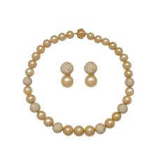 Pearl Elegance    This necklace set by Anmol is crafted in 18 K gold and set with golden south sea and round brilliant diamonds.