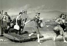 Wartime nurses getting out of the boat.