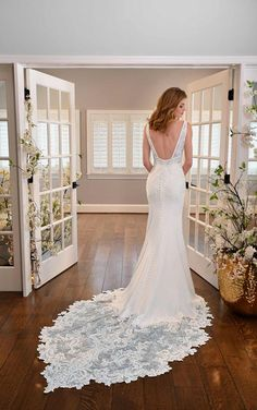Wide straps come together at a deep V-neckline in the front, and in the back, they create a square effect to show off an open back. Stunning lace details along the double-banded bodice are encrusted with delicate beading. Fabric-covered buttons along the booty cup are an unmistakably bridal finish to this chic wedding gown. The best part? The details on this train are oh-so-glamorous. Encrusted beadwork adorns a lace scalloped edge for a truly spectacular train. Designer Wedding Dresses, Wedding Gowns, Essense Of Australia Wedding Dresses, Wedding Dress Necklines, Chic Wedding, Classic Beauty, Lace Applique, Bridal Collection, Tulle