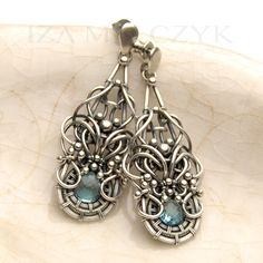 By Iza Malczyk, sterling silver and blue topaz
