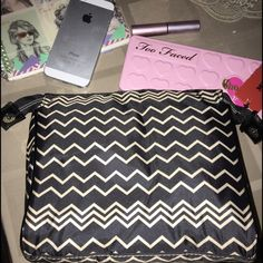 Missoni for Target Cosmetic Pouch A cosmetic puch from the Missoni for Target Collab Line. It has a zipper and buttons on the side to snap and a deep opening and can fit a lot. I put my make up pallete inside to show how deep and long it is Missoni Bags Cosmetic Bags & Cases