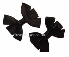Black grosgrain ribbon hair bows on alligator clips - £2.50 a pair www.dreambows.co.uk