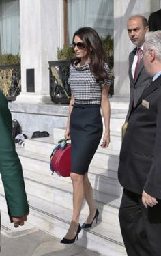 Amal Clooney in Greece wearing Oscar de la Renta - black and white gingham top and black skirt dress with red bag.jpg