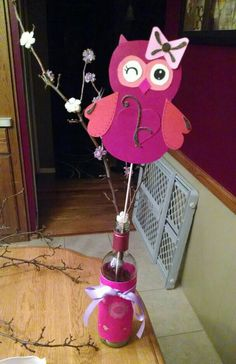 Baby shower owl centerpiece! Branches with hot glued flowers. Owl made separately with card stock and scrapbook embellishments. #girl #babygirl #owl #owls #babyshower #pink #flowers #branches #centerpiece #repin!