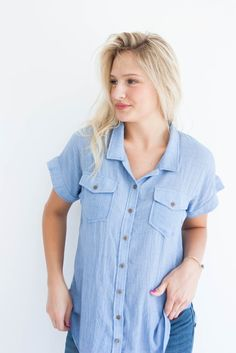 "details:  solid button down unique off-set pleat in back two front buttoned pockets model is 5' 9"" and wearing a size small"