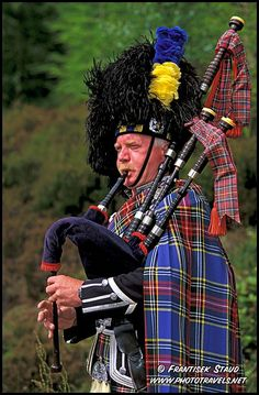 Scottish Bagpiper in his traditional costume, Scottish Highlands