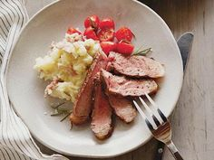 Anne gets the perfect sear for her Grilled Steak with Rosemary and Garlic by putting them on a hot spot on the grill and cooking them until nice and brown.