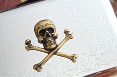 Skull & Crossbones Business Card Case Mixed Metals Vintage Inspired Gothic Victorian Steampunk Pirate Silver Plated Card Holder. $48.00, via Etsy.