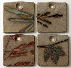 Stoneware Pendants with embossed grasses. Only imprint is glazed. Cone 6. NorthStar Pottery.