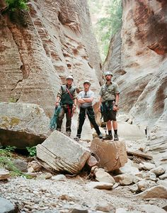 """The adventurers at Zion Adventure Company in their """"office."""" likes the group from Rutte, Samson and Pechtold = Mountains to climb."""