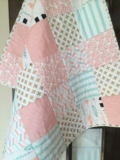 Peach and mint patchwork baby quilt by CreateInMeHandmade on Etsy