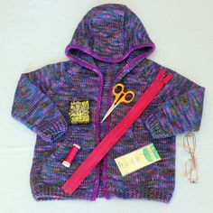 Mom's lovely R&R Hoodiepictured in this tutorial was knit in our Iris colourway with a contrasting icord edging done in Jewel. I'm happy to  report that the 4 year old girl it was gifted to loves it.  Hello friends! As you may know, my mother happens to be the world's best at  sewing a zipper into a knitted garment. I often ask her to sew zippers into  my finished knits for me and today she's going to walk us through exactly  how she does it. The truth is, there is no secret, it's all…