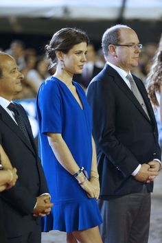 Charlotte Casiraghi (L) and Prince's Albert II of Monaco (R) stand during the podium ceremony at the 2013 Monaco International Jumping as part of Global Champions Tour on June 29, 2013 in Monaco.