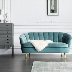 Plush Velvet Accent Love Seat Sofa with Brass Legs. Features:A timeless classic updated with beautiful Teal Blue fabric upholstery that evokes distressed Velvet fabric. Complementing traditional and transitional furnishings, this sofa is equally inviting in family room, bedroom or home office. Soft cushioned seat, offering a supreme level of comfort; Foam filled with webbed support; Modern metal plating golden legs; UK Fire Retardant Foa...
