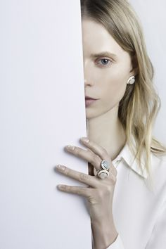 The interplay of geometric form and semiprecious stones highlights the GEO Collection of rings and earrings from S/H KOH. Moonstone, onyx, and chalcedony are captivatingly set in sterling silver or 14k gold and finely finished with graphic enamel accents. Truly modern classic design.