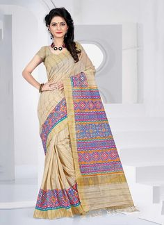 Rich look attire to give you�re a right choice for any party or function. We unfurl our intricacy and exclusivity of our creations highlighted in this lovely beige cotton   casual saree. This beautiful attire is showing some amazing embroidery done with patch border work. Comes with matching blouse.