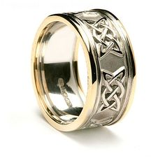 This is a lovely example of our wider Celtic wedding bands which allows the Lovers knot design to be clearly seen. The knot pattern is polished gold set against a matt finish and the band is in 10k or 14k white gold, with a contrasting yellow gold trim, or if you prefer a matching white gold trim. Every version of the ring will carry the hallmark of the Dublin Assay Office, which guarantees the high quality. The name Sheenagh is an Irish form of Jane and means God is gracious. It could be…