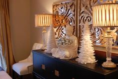 In this photo from Decorpad, Suzie used white trees and a beautiful Buddah from Z Gallerie to give her dining room sideboard an elegant holiday look.