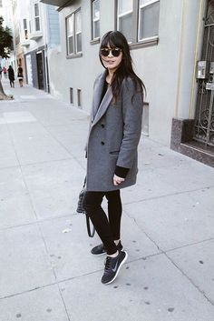 Pair a grey coat with black leggings for a refined yet off-duty ensemble. For the maximum chicness rock a pair of black low top sneakers.  Shop this look for $65:  http://lookastic.com/women/looks/sunglasses-long-sleeve-t-shirt-coat-leggings-low-top-sneakers/6435  — Dark Brown Sunglasses  — Black Long Sleeve T-shirt  — Grey Coat  — Black Leggings  — Black Low Top Sneakers