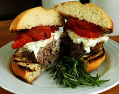 By Sportsglutton Our Memorial Day recipes continue with Greek Lamb Burgers. I've been somewhat obsessed with lamb burgers recently (probably because I have 10 pounds of ground lamb in the freezer)… Food Network Recipes, Cooking Recipes, Healthy Recipes, Healthy Foods, Lamb Burger Recipes, Greek Burger, Memorial Day Foods, Lamb Burgers, Roasted Tomatoes