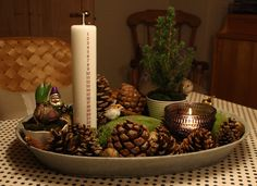 Play up your decoration with extra candles, a potted plant, pinecones and other ornaments. This will make for a great centerpiece on a large table.