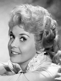 Donna Douglas was an American actress and singer, known for her role as Elly May Clampett in CBS's The Beverly Hillbillies.