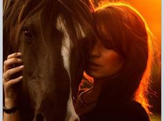 Horse and girl - beautiful orange lighting