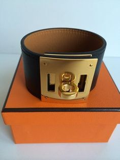BNIB Hermes BLACK Kelly Dog Bracelet in GHW Swift Leather CDC Cuff. Get the lowest price on BNIB Hermes BLACK Kelly Dog Bracelet in GHW Swift Leather CDC Cuff and other fabulous designer clothing and accessories! Shop Tradesy now