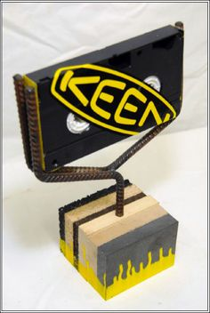 Part Industrial Chic, Part Do-It-Yourself, all ode to the basics of life, this Table-Top Keen® Yellow Branded Sign Stand could not… Retail Fixtures, Logo Sign, Industrial Chic, Retail Design, Signage, Recycling, Branding, Yellow, Footwear