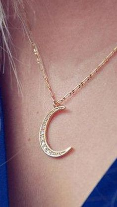Rhinestone-encrusted gold crescent moon necklace