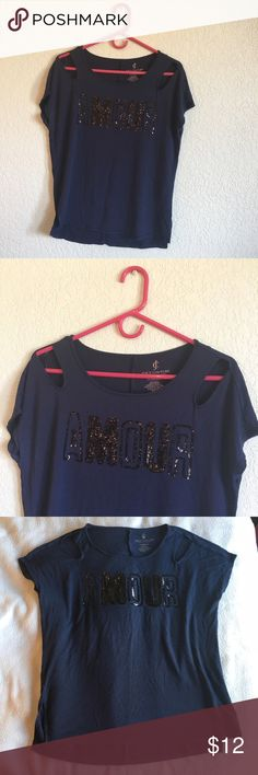 "Juicy Couture Blue ""Amour"" Top with Black Sequins Cute Juicy Couture top with cutouts at shoulders and small slits at the bottom on each side. Pretty black sequin lettering that says ""amour"" which means ""love"" in french! :) Its an extra small but fits loosely as it is meant to be flowy! Only one spot where the sequins seem to be a little messed up (see picture) but not too noticeable! Reasonable offers accepted :) Juicy Couture Tops"