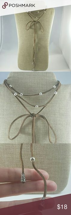 Brown Leather Wrap Choker Brand New leather choker necklace by small handmade jewelry company based out of Southern California, JFOX Jewelry. Leather strap is chocolate in color with silver accent beads. The beads are adjustable on the strap so you can wear it several different ways. Either wear this choker in a bow or let it hang long. This is an awesome addition to your accessory collection. JFOX Jewelry Jewelry Necklaces