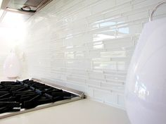 white glass tile backsplash Kitchen Midcentury with backsplash glass backsplash Glass Beige Cabinets, Backsplash For White Cabinets, Grey Backsplash, Glass Tile Backsplash, Backsplash Ideas, Tile Ideas, Tile Grout, Vanity Backsplash, Glass Tiles