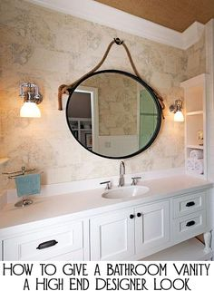 Most people's bathroom vanities were built by a builder who was more interested in saving money than good design.  They tend to all look the same - white cabinets without hardware, large unframed sheet mirror, basic light fixtures, and that is about it.  Here are a few ways to give a bathroom vanity a high end designer look.