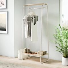 Find a great selection of garment racks and wardrobe closets for sale at Wayfair. They're perfect for the home, on set at a photo shoot, or for commercial use at a clothing store. Order your new clothes rack today! Diy Wardrobe, Wardrobe Design, Wardrobe Rack, Wardrobe Ideas, Closet Ideas, Storage Organization, Storage Spaces, Wall Storage, Clothing Organization