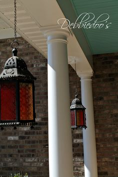 Hanging candle lanterns on the front porch