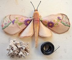 These are fantastic - moths made from remnants of vintage embroidered linens. These were created by Mister Finch in the UK. I adore them! ...