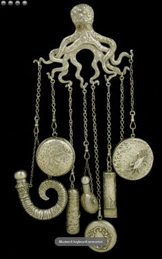 Sterling silver octopus chatelaine holding a compact, perfume bottle, mirror, whistle, and pin holder; USA, Gorham & Co., circa 1882-92.