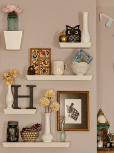 Playful Display Have fun with shapes and angles when you group shelves of different sizes into a pretty, 3D wall collage.
