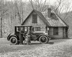 Shorpy Historical Photo Archive :: Washington, D.C., 1924. Taking the dog for a drive and a walk, it looks like. The building is the Joaquin Miller cabin at Rock Creek Park.
